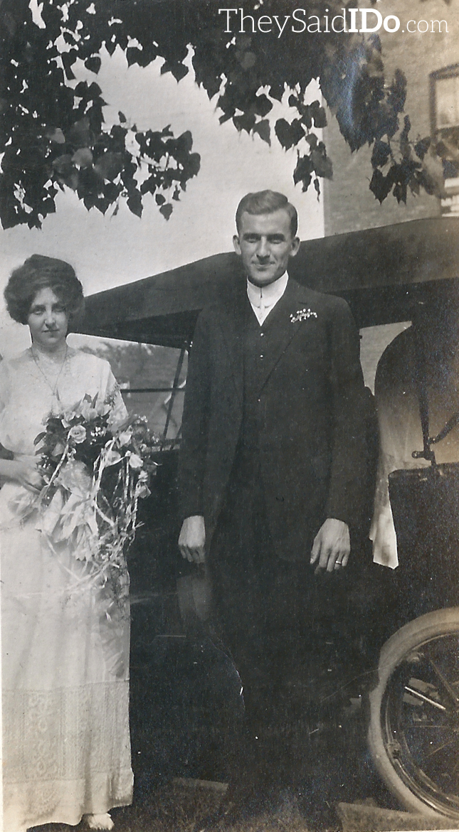 Couple in front of a car - 1910s {TheySaidIDo.com}