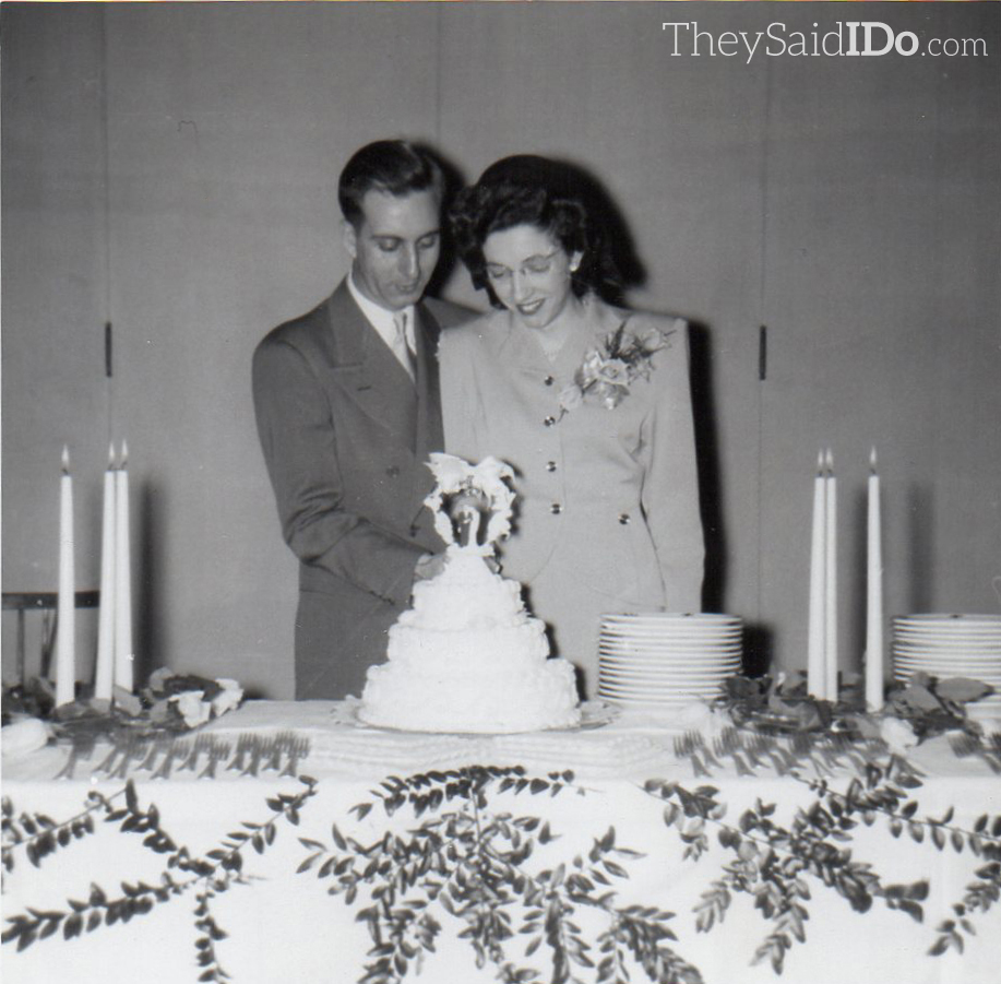 Jack and June cut the cake.  The reverse is imprinted: Linprints - Linn Camera Shop, Lansing May 19, 1947