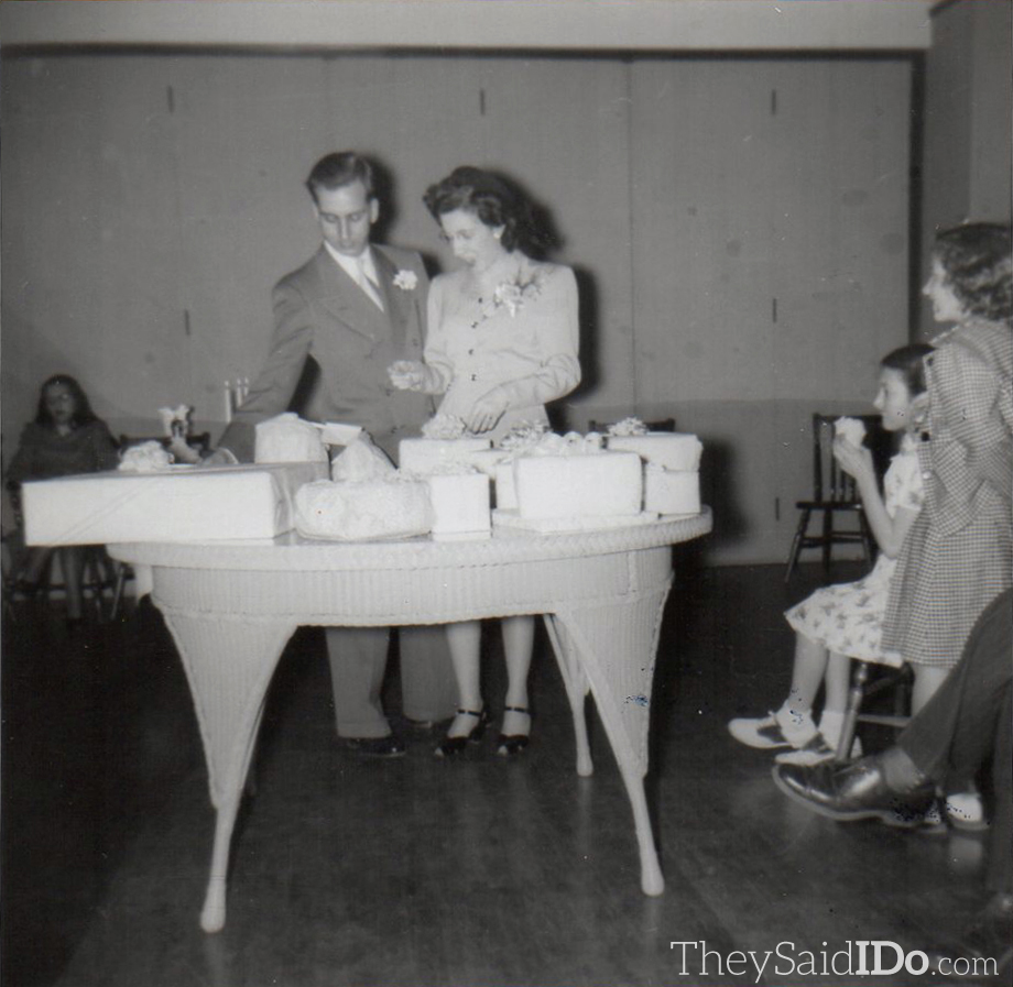 Jack and June survey wedding presents from their guests. The reverse is imprinted: Linprints - Linn Camera Shop, Lansing May 19, 1947