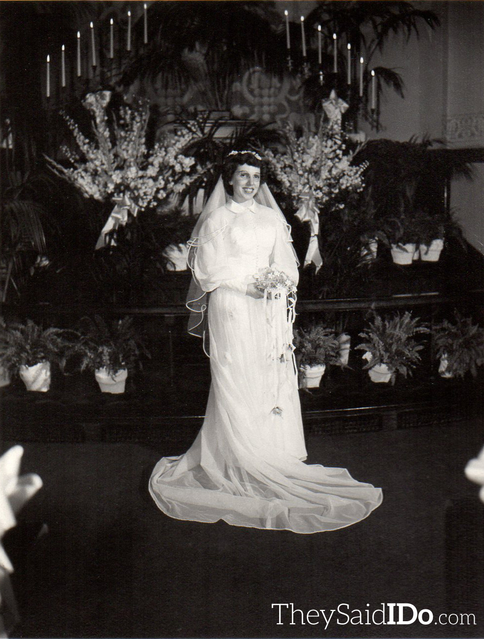 The bride, Inez. Notice the striking resemblance between her and her sister! Lansing, MI 1951 {TheySaidIDo.com}