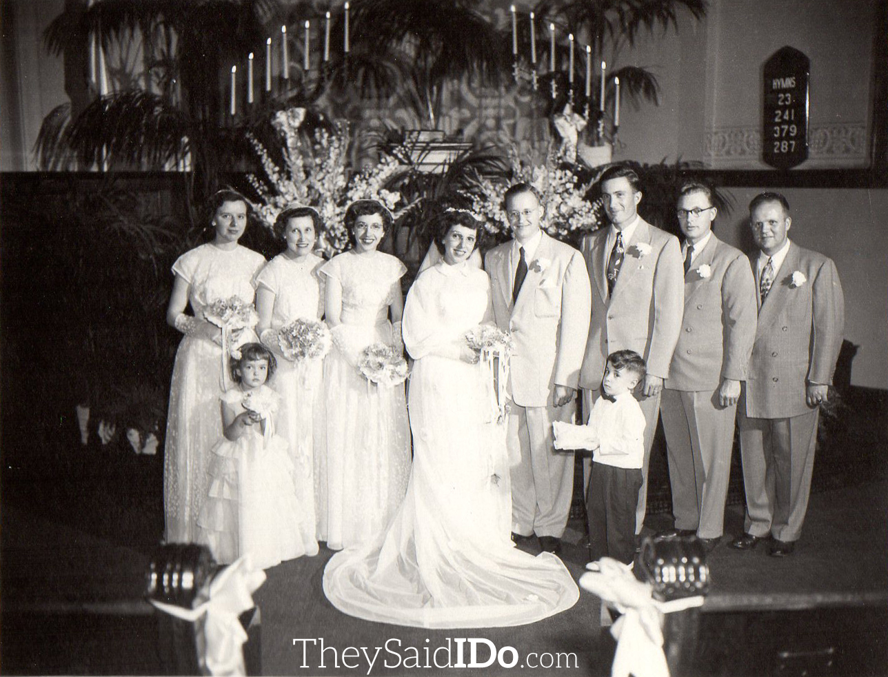 Byron, June and their entire wedding party. Sister June is the matron of honor.  Lansing, MI 1951 {TheySaidIDo.com}
