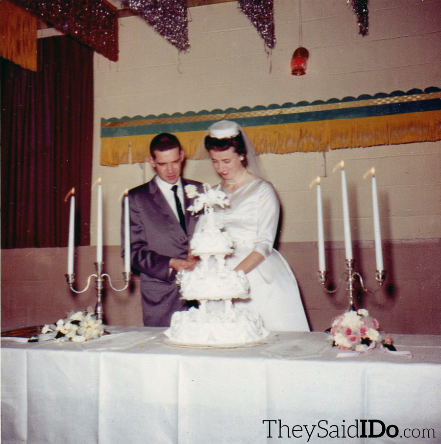 The bride and groom cut the cake - April 23, 1962 {TheySaidIDo.com}